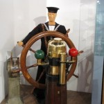 Display of a sailor at the helm welcomes visitors to the museum