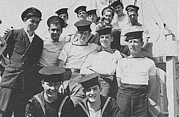 """Crew of MTB 462 with 'Chaulkers', boat's mascot. 'Chaulkers' is a Royal Navy word meaning """"fed up"""". (PA 180039)"""