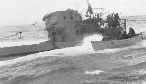 HMCS CHILLIWACK's boat crew boards U744 in the North Atlantic. Forty men of her