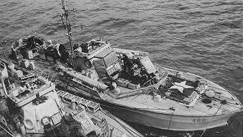 Inboard boat shows racks of small depth charges. (PAC PA 144573)