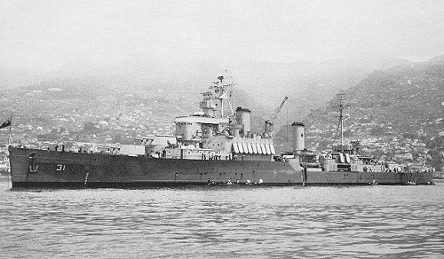 The cruiser, HMCS QUEBEC, rests at anchor.